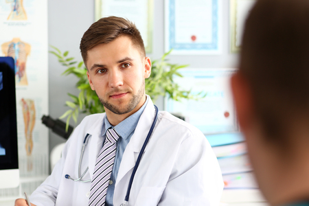Doctor in white uniform with stethoscope