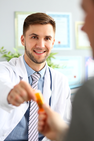 Medico giving tablets to patient