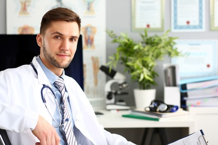 Cheerful doctor in clinic office Stockfoto