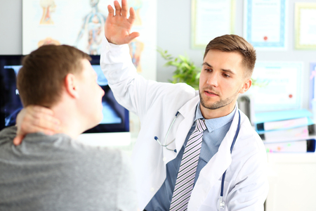 Doctor showing exercises for health