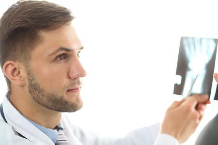 Doctor explaining something to patient Stockfoto