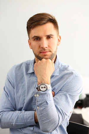Portrait of smart man looking at camera with