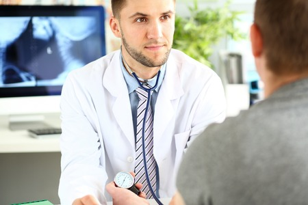 Young specialist in clinic cabinet
