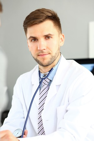 Thoughtful doctor posing in clinic