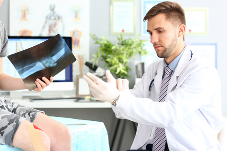 Smart doctor wearing gloves Stockfoto