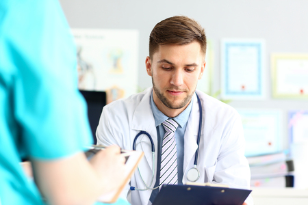Thoughtful doctor reading documents