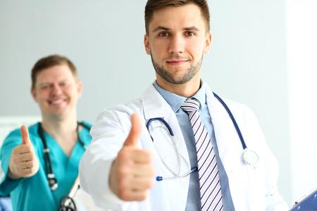 Doctors demonstrating approval sign Stockfoto