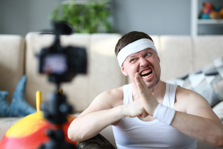 Blogger with Funny Face Record Fitness Exercise