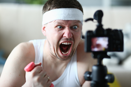 Screaming Man Holding Dumbbell Record on Camera