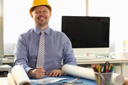 Happy Workman Sketching Building Blueprint at Desk Stock fotó