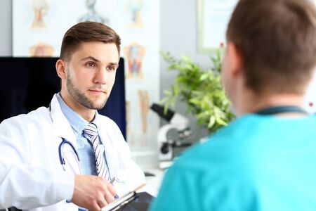 Doctor talking with colleague