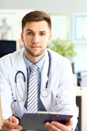 Happy doctor at workplace