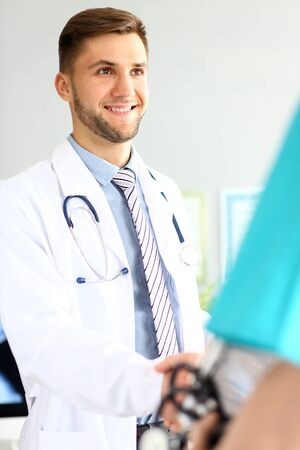 Friendly cheerful doctor