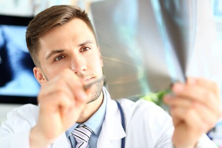 Doctor looking at x-ray image Stockfoto
