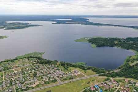 Photo of a lake on top helicopter blue water