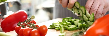 Professional Chef Hand Chopping Fresh Cucumber