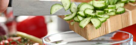 Organic Small Chopped Cucumber Slices Pouring Bowl