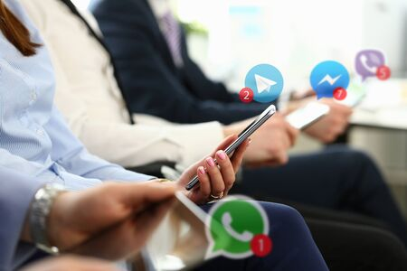 Group business people hold mobile device Editorial