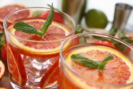 Red orange punch home made cocktail closeup