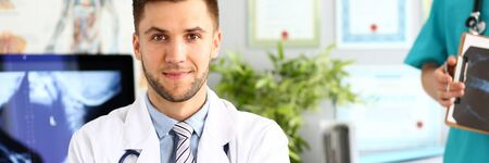 Doctor posing in clinic cabinet