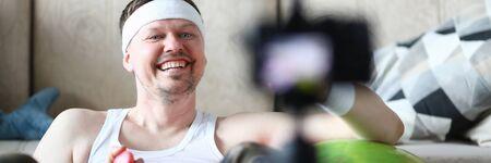 Happy Sportsman Recording Sport Video on Camera Banco de Imagens