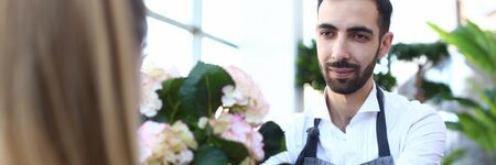 Bearded Man Florist Giving White Flower Hortensia Stock Photo