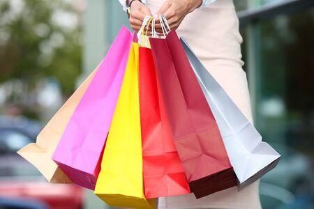 Female standing near dress store holding Stockfoto - 128603891