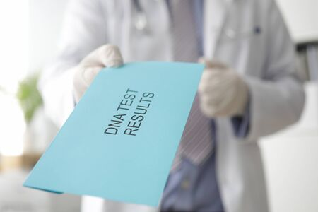 Male doctor hand holds out an envelope Imagens