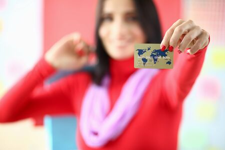 Bauty woman holding plastic credit card