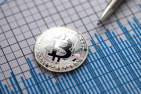 Coin crypto currency bitcoin with silver pen
