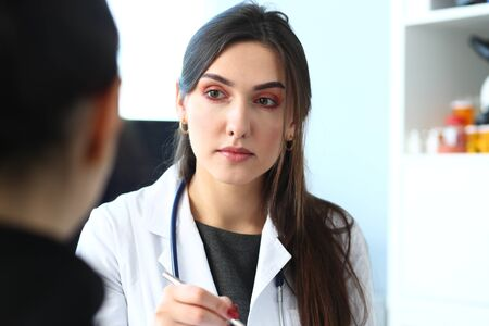 Beautiful smiling female doctor talk with patient about his history list. Physical exam er anamnesis communication disease prevention ward round 911 prescribe remedy healthy lifestyle concept