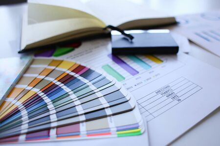 Color print of pantone statistics offset organization gives customer an order products for distribution during promotion concept Banco de Imagens