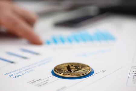 businessmen study documents analyze information make deal digital currency concept closeup Zdjęcie Seryjne