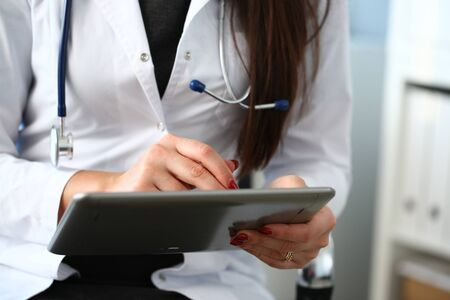 Female doctor hands hold and show digital tablet pc to patient explaining diagnosis. Physical disease prevention 911 therapeutist prescribe remedy healthy lifestyle modern technology concept