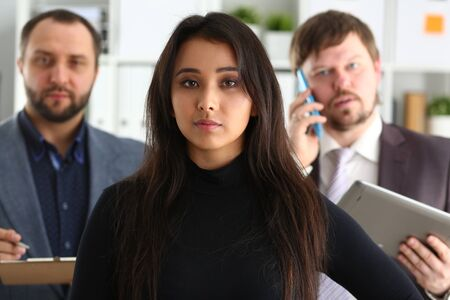portrait of young successful businesslady and two businessmen in office coworkers lovely job concept
