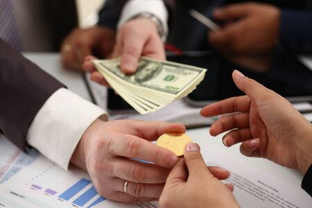 businessmen change currency make successful deal hold money in arms wealth concept