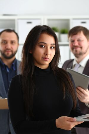 portrait of young successful businesslady hold laptop and two businessmen in office coworkers lovely job concept Stockfoto