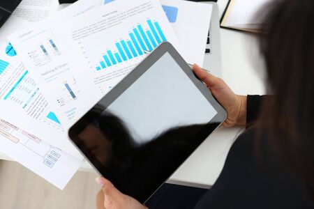 businesswoman study documents hold tablet in her hands closeup a lot of work concept Stockfoto