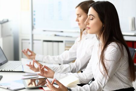 Two businesswoman relaxed in office sit table portrait. Business calm concept. Workplace focus thoughts. Make right decision.