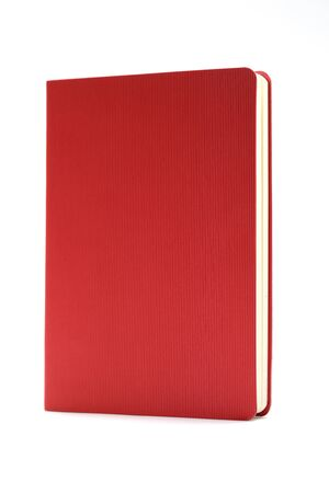 Red diary isolated on white background. Business education concept. Office supplies.