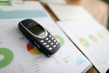 Minsk, Belarus - 18 September 2019: Nokia 3310 ol phone with business chart. Illustrtive editorial Publikacyjne