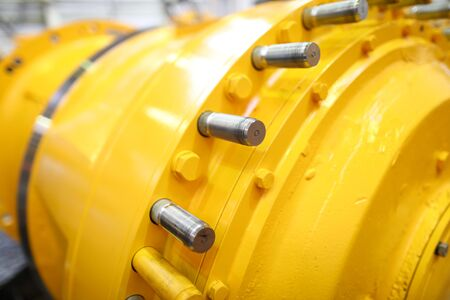 Unrecognizable yellow row part of some machine or station closeup. Deep water bathyscaphe or pressure chamber or gaz hardware concept