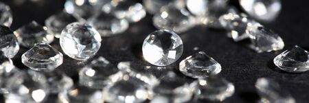 Scattering of white star diamonds on black background table jeweler concept Stock Photo