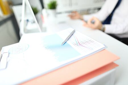 Focus on charts and graphs used by banking businessman checking information of business document in modern office. Businessman analyze marketing data. Stress relieve concept Banco de Imagens