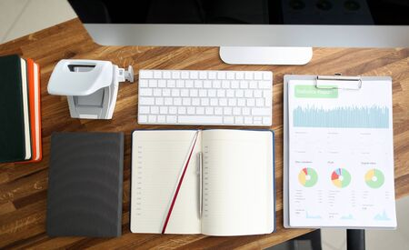 Empty business office with stationery lie on wooden table background. Workplace organization concept