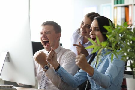 Group people in office correctly solved problem and shout yes we won. Business staff succes celebration unity achievement. Big total sale concept Stock fotó