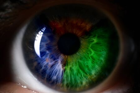 Red green blue human eye close up background. Color perception blindness concept