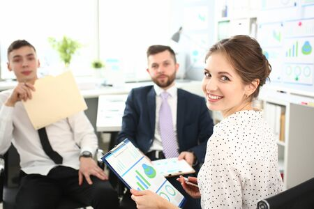 Portrait of smart people sitting in modern conference room and talking about important contract or discussing business agreement. Company meeting concept