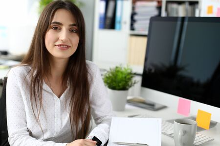 Portrait of smiling businesslady writing possible future plans. Cute businesswoman breaking off for lunch on job. Business and art design concept. Blurred background