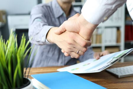 Two business people shaking hands as future prospects symbol close-up Stock Photo